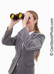 Side view of bank employee with spyglasses