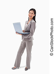 Side view of laughing businesswoman with notebook