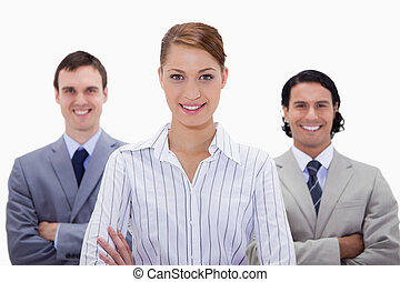 Smiling businessteam with arms folded