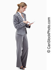 Side view of bank employee using tablet