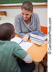 Portrait of a smiling teacher explaining something to a pupil