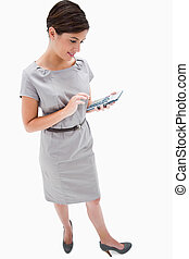 Side view of woman with hand calculator