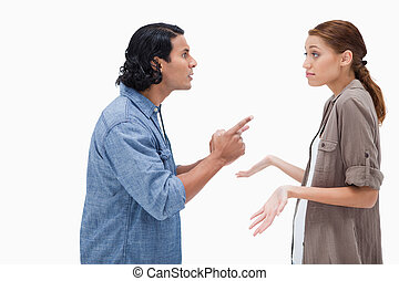 Side view of man asking his clueless girlfriend