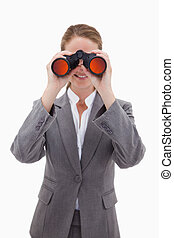 Bank employee looking through spyglasses against a white...