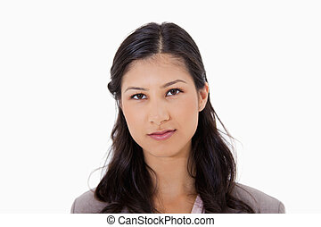 Serious looking woman against a white background