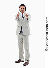 Portrait of an office worker posing with the thumbs up...