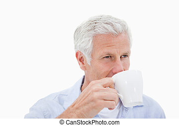 Mature man drinking coffee