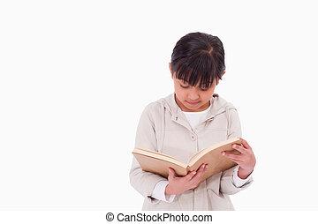 Girl reading a book against a white background