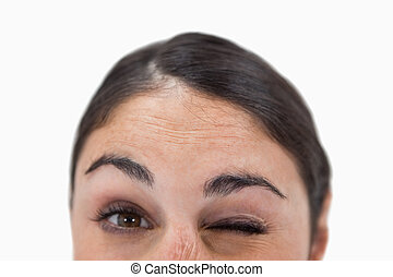 Close up of a woman winking