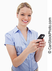 Smiling woman holding her cellphone