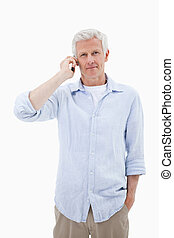 Portrait of a mature man using his mobile phone