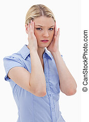 Woman with headache against a white background