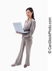 Side view of laughing businesswoman with laptop
