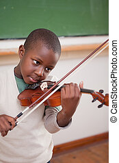Portrait of a schoolboy playing the violin