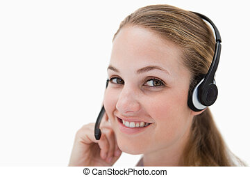 Side view of smiling call center agent with headset