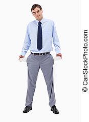 Broke businessman showing his empty pockets
