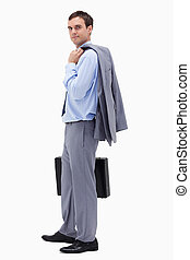 Side view of businessman with suitcase