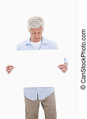 Portrait of a mature man looking at a blank panel
