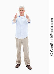 Man with the thumbs up against a white background