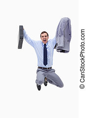 Businessman with suitcase in mid air against a white...