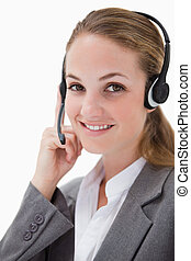 Side view of smiling female call center agent