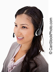 Smiling female call center agent at work