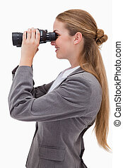 Side view of smiling bank employee with spyglasses