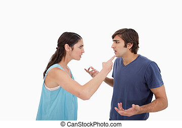 Young couple arguing against a white background