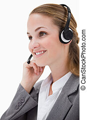 Side view of listening call center agent with headset on
