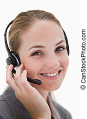 Happy smiling call center agent at work against a white...