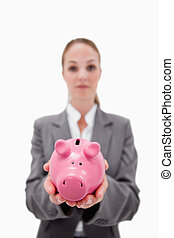 Piggy bank being held by bank employee