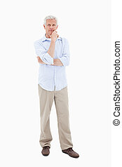 Mature man posing against a white background