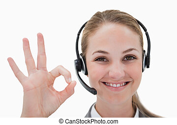 Smiling call center agent approving