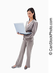 Side view of businesswoman standing with notebook