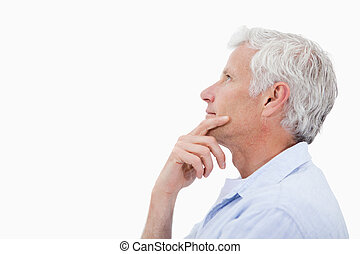 Side view of a man thinking against a white background