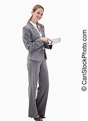 Side view of smiling bank employee using tablet