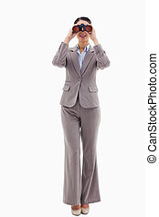 Portrait of a businesswoman looking through binoculars