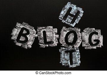 Crossword of Hot Blog written in chalk on a blackboard