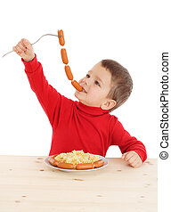 Little boy with chain of sausages, isolated on white