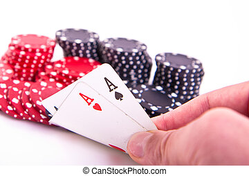 ace of hearts and black jack with poker chips on white...