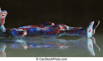 Alien autopsy - Alien with blue eyes, on glass table