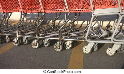 Shopping carts. - Nested shopping carts get pushed along the...