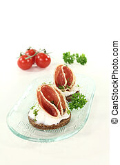 Hors d oeuvre - Pumpernickel bread with cream cheese, salami...