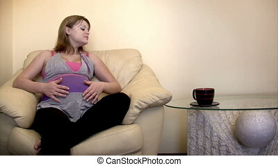 Pregnant woman having tea