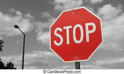 Stop sign. Grey timelapse clouds. - Stop sign with grey...