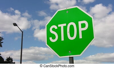 Green stop sign - Confusing stop sign with green for go...