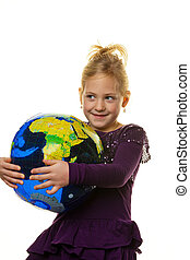child with a globe - a little girl child looks at a globe
