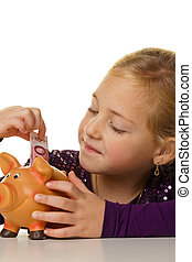 child with a piggy bank. euro sham save - a small child puts...