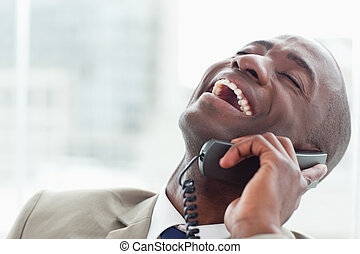 Close up of a delighted businessman on the phone