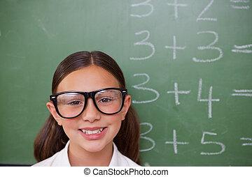 Smiling smart schoolgirl posing
